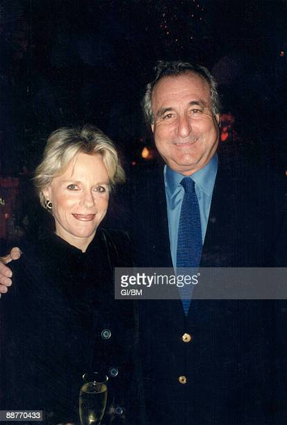 ACCESS*** Financier Bernard Madoff and his wife Ruth Madoff attend a holiday party during December 1996 in New York City