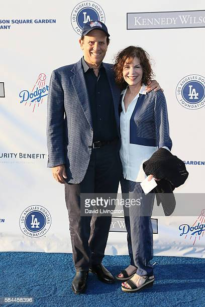 Financier Michael Milken and guest arrive at the Los Angeles Dodgers Foundation Blue Diamond Gala at the Dodger Stadium on July 28 2016 in Los...