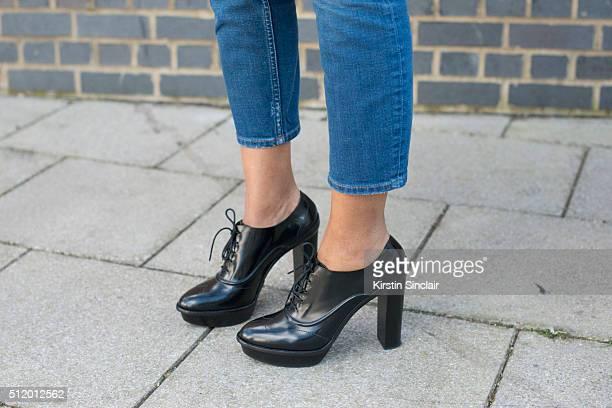 Financier Noreen Goodwin wears Paul Smith shoes on day 5 during London Fashion Week Autumn/Winter 2016/17 on February 23, 2016 in London, England.