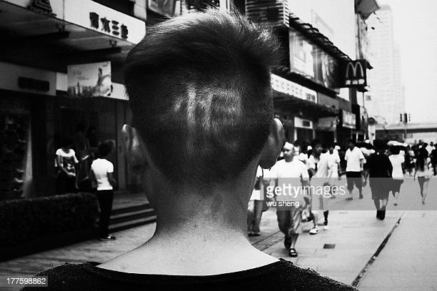 """Find a man in the street, his hair cut a word """"hate"""""""
