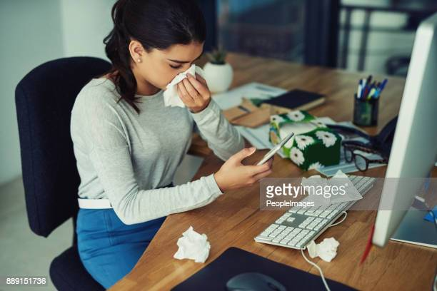 finding her gp's number in her contacts list - cold virus stock pictures, royalty-free photos & images