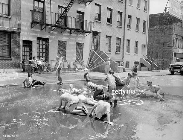Finding relief from the 96 degree heat which hit New York these youngsters revel under the cool sprinkling water coming from a fire hydrant This is...