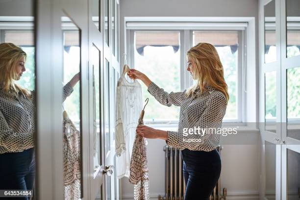 finding that perfect outfit - top garment stock photos and pictures