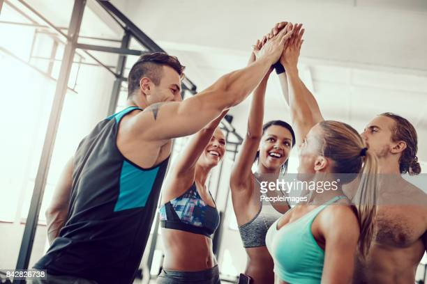 finding their way to their fitness goals together - center athlete stock pictures, royalty-free photos & images