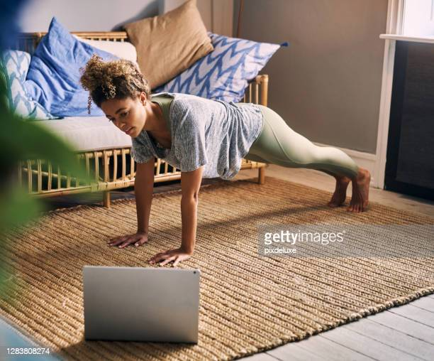 finding time for fitness is easier with home training - plank position stock pictures, royalty-free photos & images