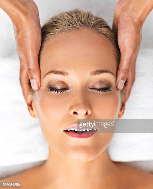 finding total relaxation - head massage stock photos and pictures