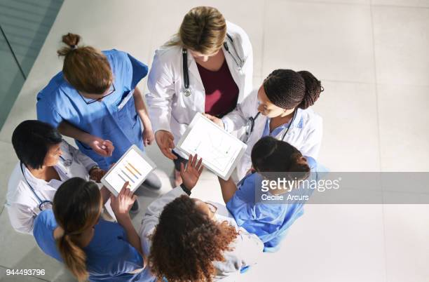 finding ways to better the standards of healthcare - group of doctors stock pictures, royalty-free photos & images