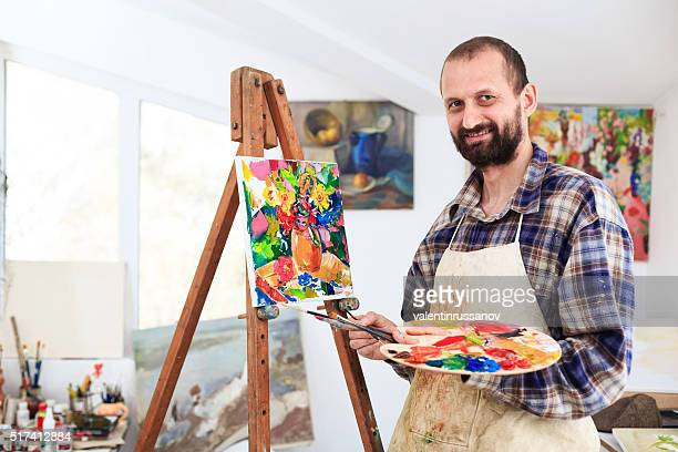 Fine art artist in his workshop