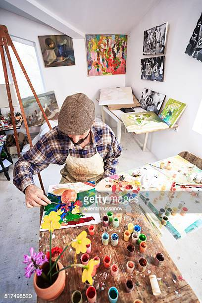 Fine art artist in his workshop-vertical