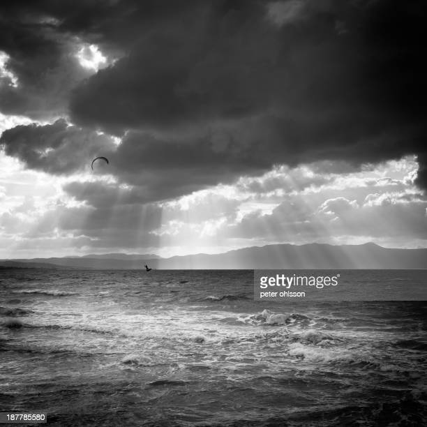 CONTENT] Fine art black and white shot of a kite surfer outside the coast of crete