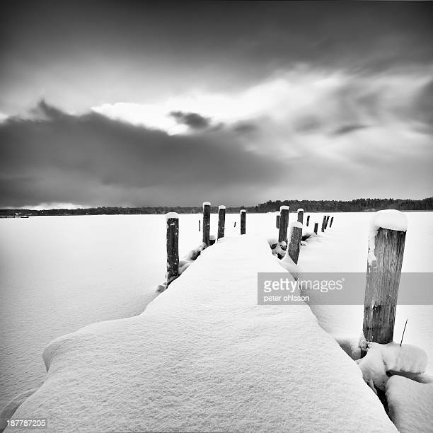 Fine art long exposure photo of a snow covered jetty.