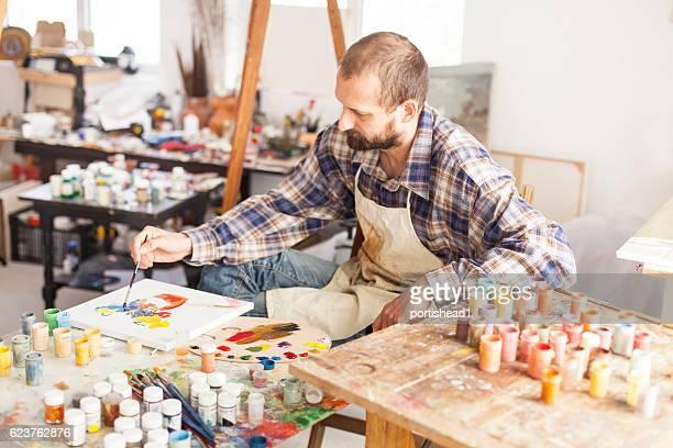 Fine art painter creating new artwork-hight angle view