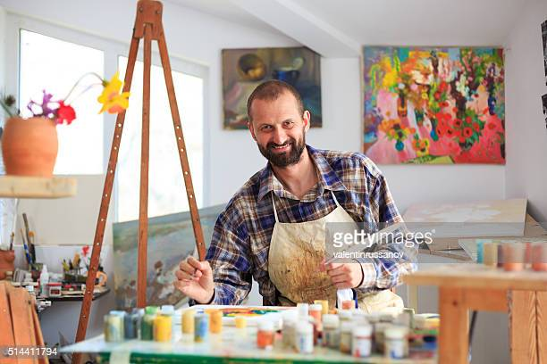Fine art painter in his workshop