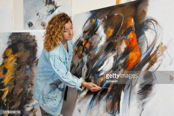 fine art painter works in studio - syolacan stock pictures, royalty-free photos & images