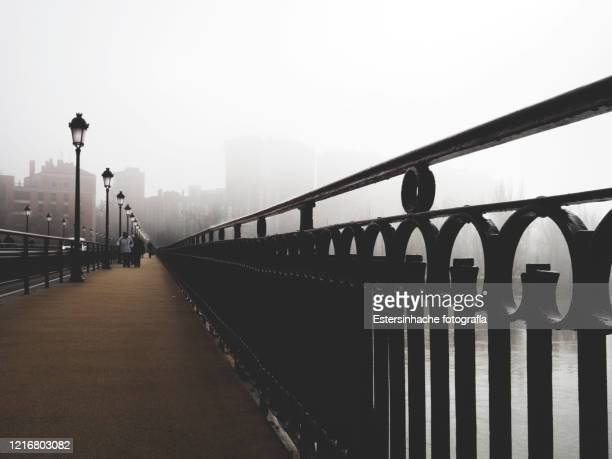 fine art photography of a bridge in the fog - valladolid spanish city stock pictures, royalty-free photos & images