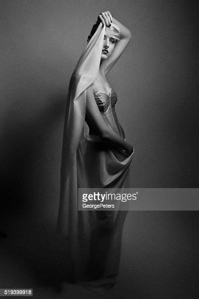Fine art portrait of a beautiful woman wearing corset