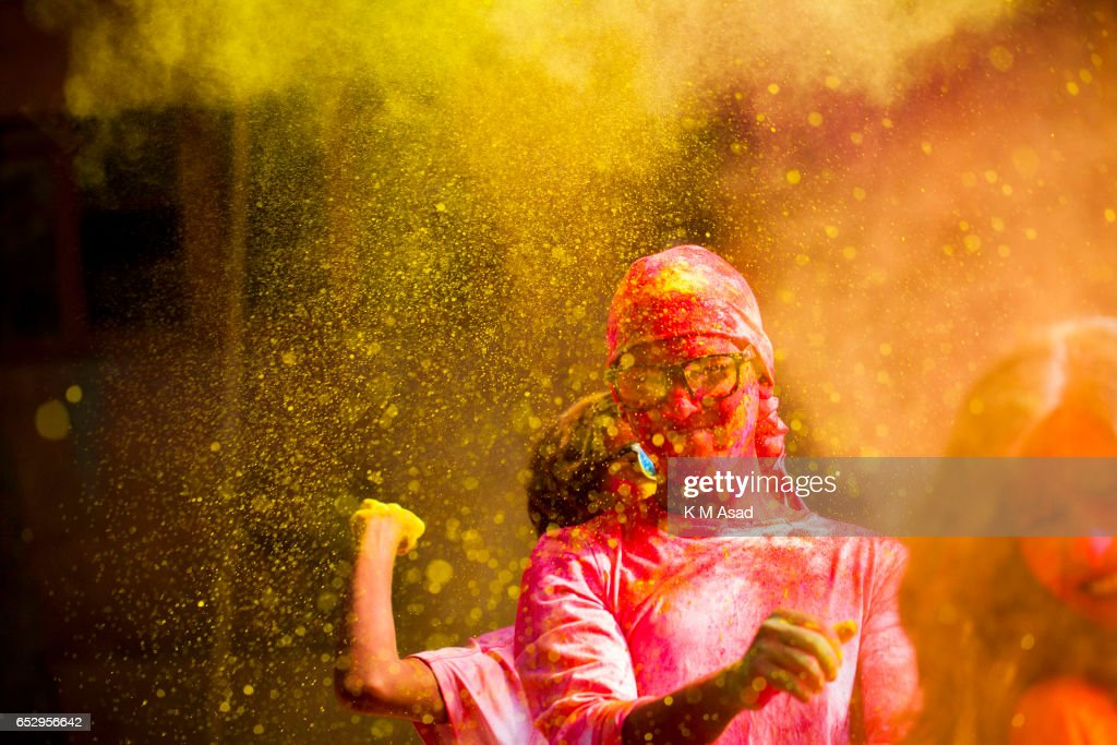 UNIVERCITY, DHAKA, BANGLADESH - : Fine Art Students celebrate the Holi Festival or Festival of Colors after smearing each other with colored powder in Dhaka, Bangladesh. Holi festival is celebrated on the full moon day in the month of Phalguna and marks the start of the spring season.