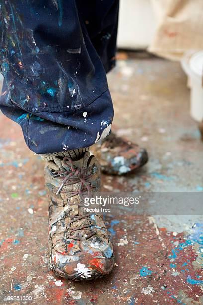 Fine artist painters feet in her studio