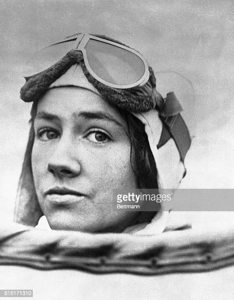 A fine closeup of Mrs Anne Morrow Lindbergh as she appeared in flying helmet in her husband's plane en route to California from this city She is...