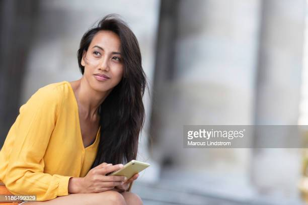 a fine day in the city - filipino ethnicity and female not male stock pictures, royalty-free photos & images