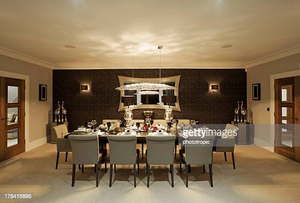 fine dining room at night - dining room stock photos and pictures