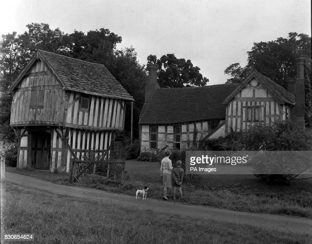 A fine example of a halftimbered manor house of the late 14th century Lower Brockhampton Hall near Bromyard Herefordshire Adjoining is a rare...