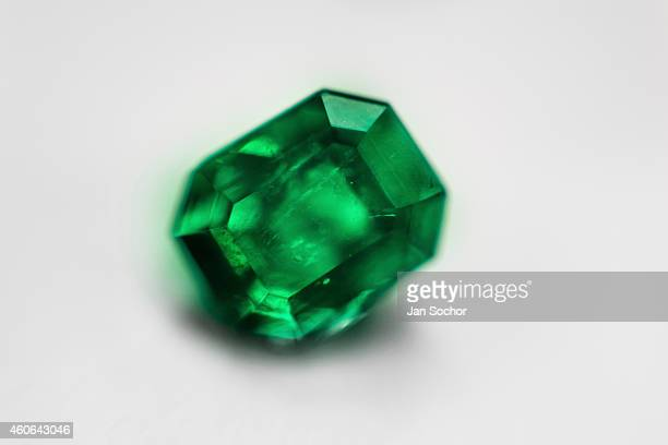 A fine rectangularshaped emerald valued between 5000 and 10000 dollars is seen in a jewelry workshop on February 08 2014 in Bogota Colombia Around...