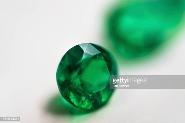 A fine roundshaped emerald valued between 5000 and 10000 dollars is seen in a jewelry workshop on February 08 2014 in Bogota Colombia Around 60% of...