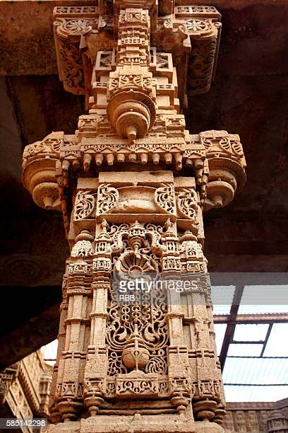 finely carved pillar of adalaj stepwell - stepwell stock photos and pictures