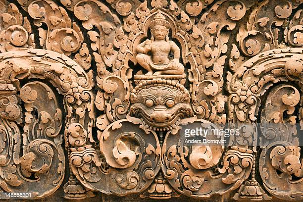 finely detailed sandstone carvings of indra atop a mythological kala at banteay srei temple. - banteay srei stock pictures, royalty-free photos & images