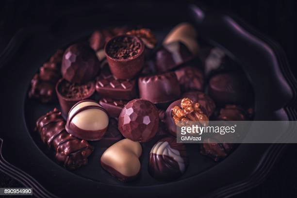 finest chocolate pralines - chocolate pieces stock photos and pictures