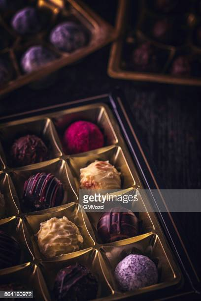 finest chocolate truffle pralines - chocolate pieces stock photos and pictures