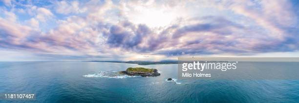 fingal heads super wide panoramic view with cook island in foreground - island stock pictures, royalty-free photos & images