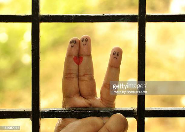 Finger art against window grill