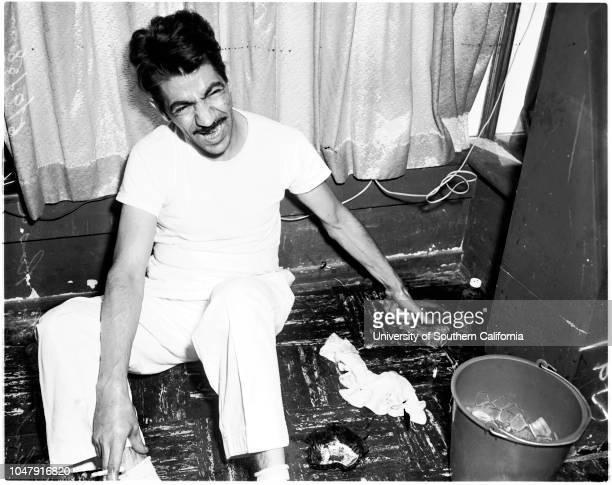Finger caught in safe 9 June 1958 Antonia La Rosa 37 years William Burns Sal Apablasa George Antouelli Caption slip reads 'Photographer Rustan Date...