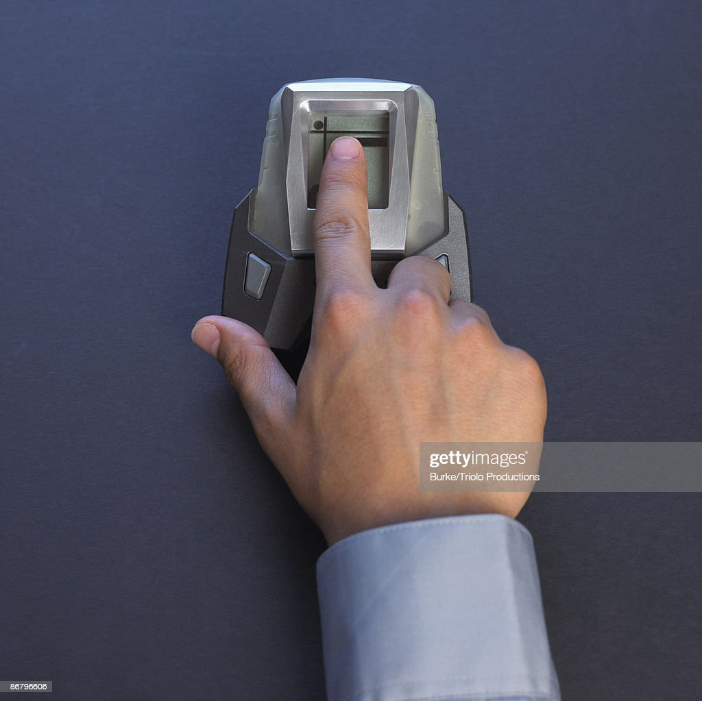 Finger in fingerprint reader : Stock Photo