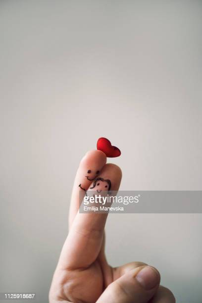 finger in love - love at first sight stock pictures, royalty-free photos & images