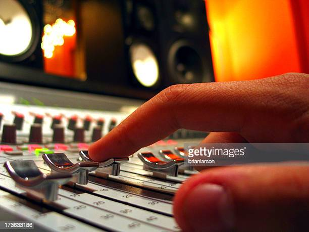 Finger on Audio Console Fader