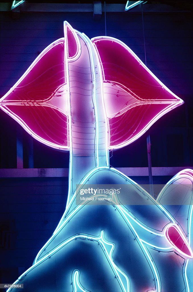 Finger on Lips, Neon Light : Stock Photo