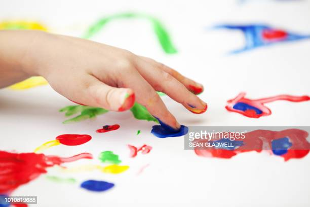 finger painting - nursery school child stock pictures, royalty-free photos & images