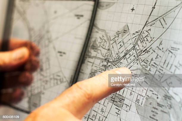 Finger Pointing at Clear Road  Map