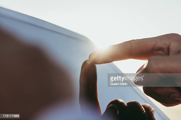 finger pointing on tablet pc screen - touch sensitive stock pictures, royalty-free photos & images