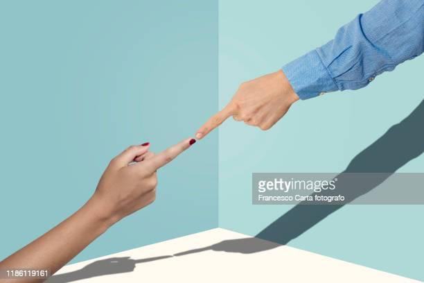 finger pointing - human arm stock-fotos und bilder