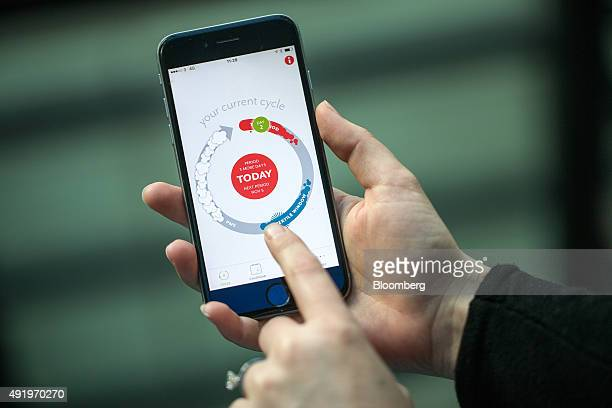 A finger points to a screen of the Clue health app made by BioWink GmbH on a smart device in this arranged photograph in London UK on Friday Oct 9...