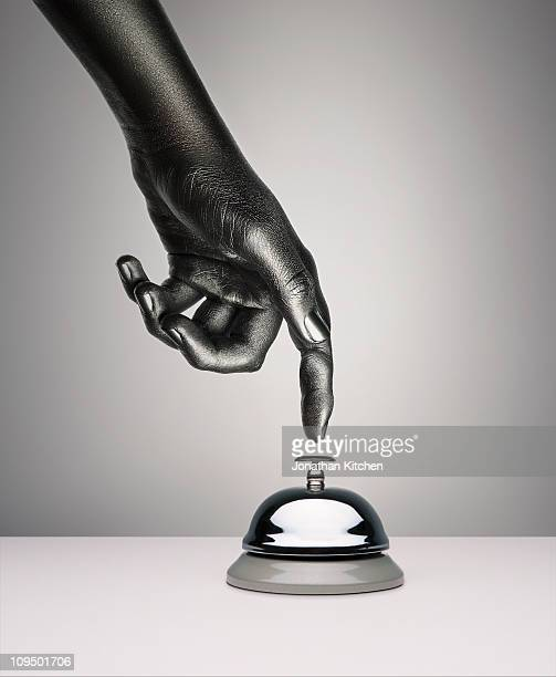 Finger pressing bell