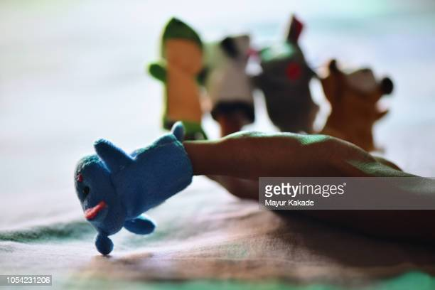 finger puppets used for storytelling - storyteller stock pictures, royalty-free photos & images