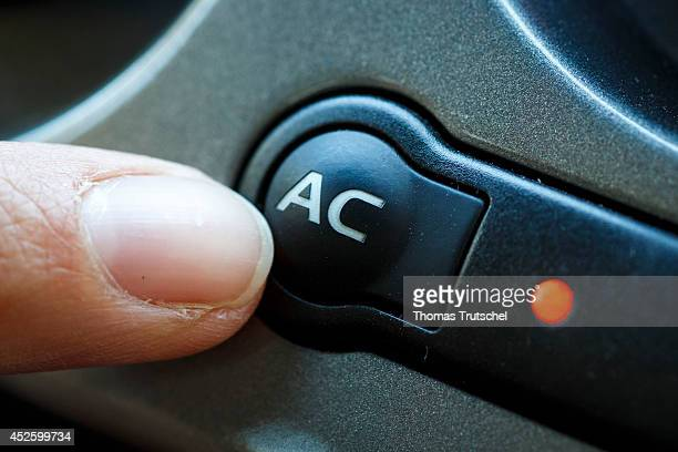 Finger pushing the button of the air conditioner in a car on July 17 in Buecheloh Germany