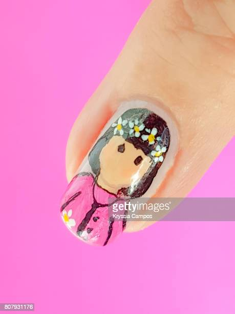 Finger showing doll design nail art