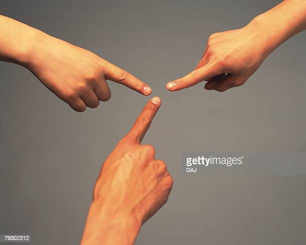 finger tips of three people reaching each other, high angle view - dedo humano imagens e fotografias de stock