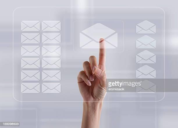 finger touching e-mail sign on transparent digital touch screen - e mail stockfoto's en -beelden